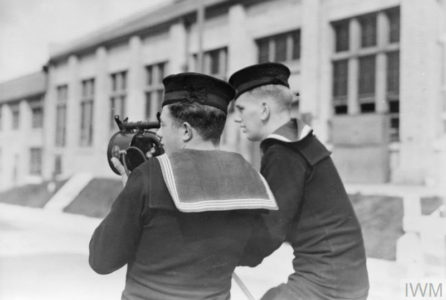 Ratings learning Morse signalling with the Aldis lamp, the current is supplied from a dynamo worked by the pedal machine. © IWM (A 11126)
