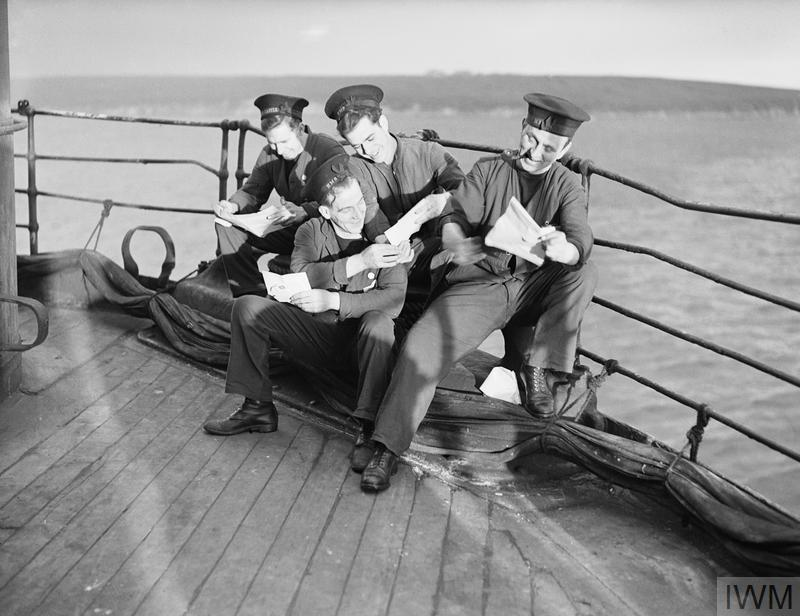 Life on board H.M.S. Dunluce. Sailors read their Christmas mail in December 1941 | © IWM A 13325